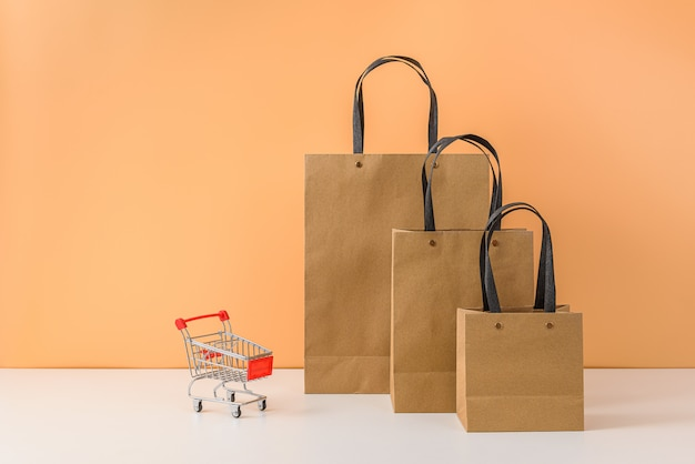 Paper shopping bags and shopping cart or trolley