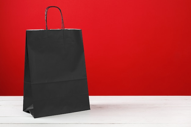 Paper shopping bags with copyspace on red
