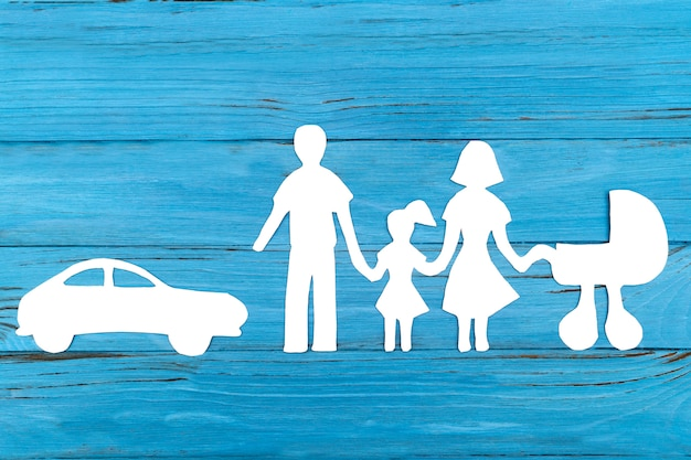 Paper silhouette of family with baby carriage