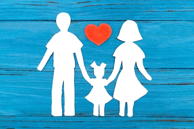 Paper silhouette of family with red heart