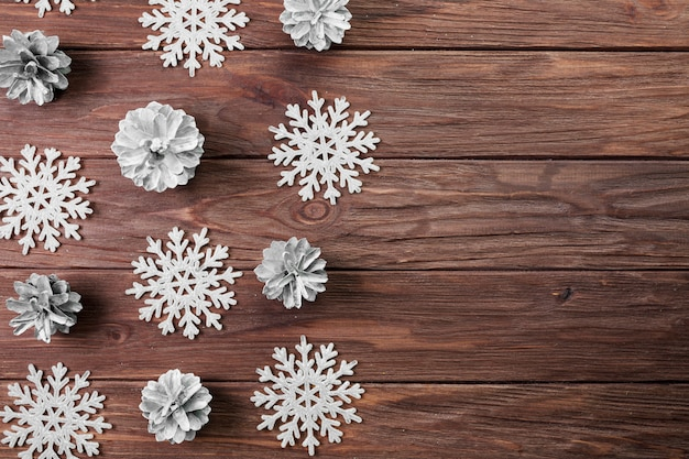 Paper snowflakes and snags on wooden board