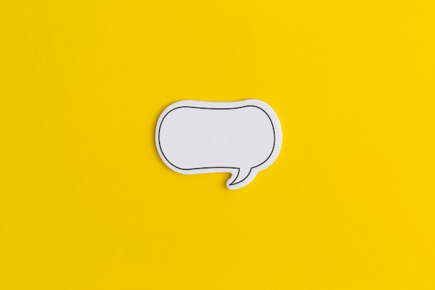 Paper speech bubble on a yellow background