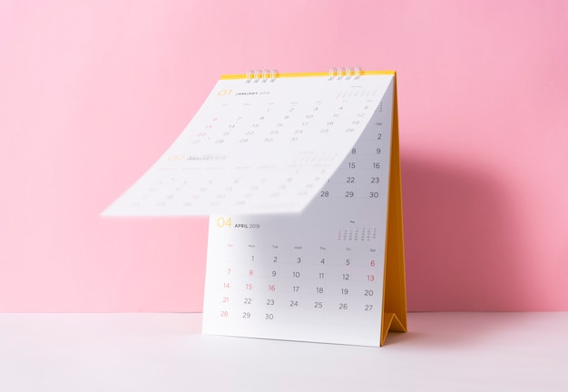 Paper spiral calendar year 2019 on pink background.