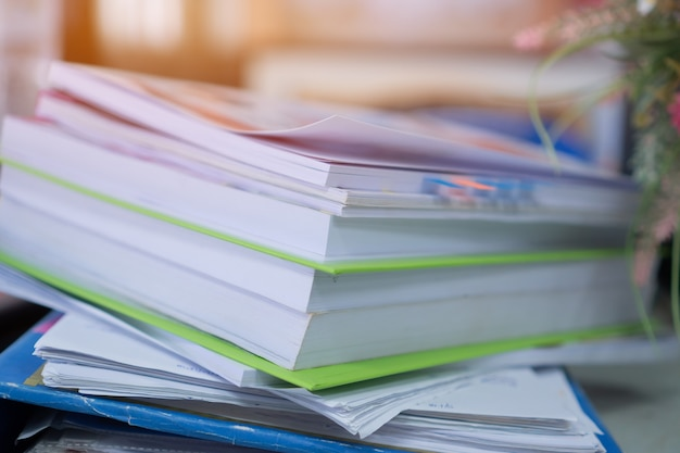 Paper stack, pile of unfinished documents on office desk folders to business functions
