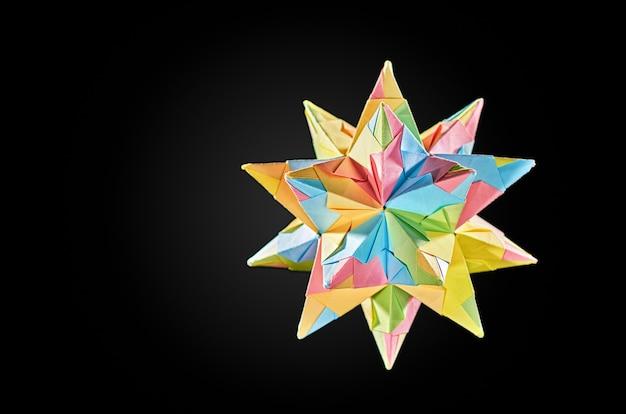 Paper star kusudama traditional japanese healing ball on grey background