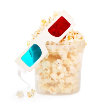 Paper striped bucket with popcorn and 3d glasses isolated on white background with clipping path.