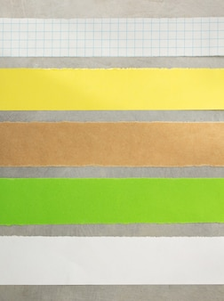 Paper strips at metal background
