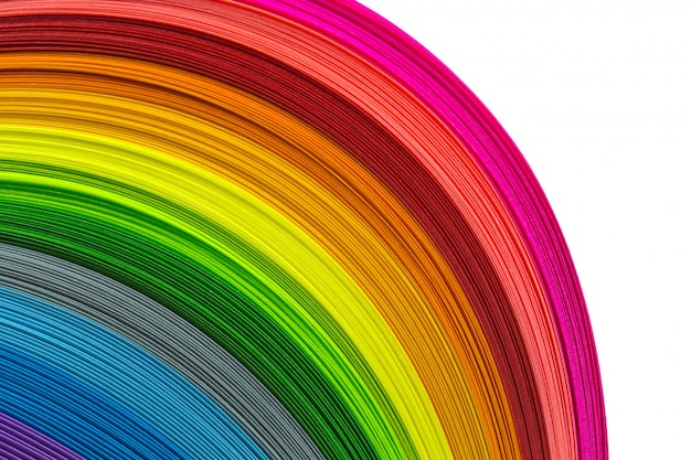 Paper strips in rainbow background