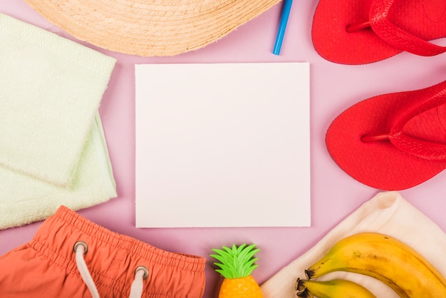 Paper between summer accessories and fruits