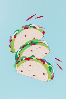 Paper tacos on blue background top view