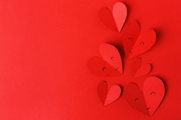 Paper valentines day hearts on red
