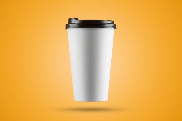Paper white coffee cup isolated on a yellow background