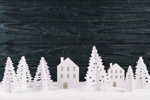 Paper winter city on wooden background