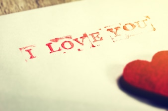 Paper with a heart and with the phrase  i love you