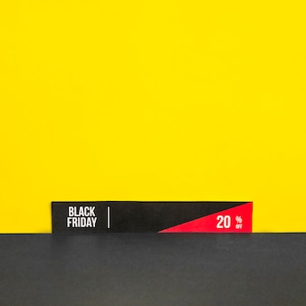 Paper with black friday inscription on yellow background