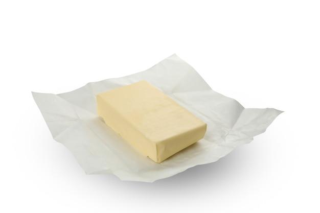 白い背景で隔離のバターと紙