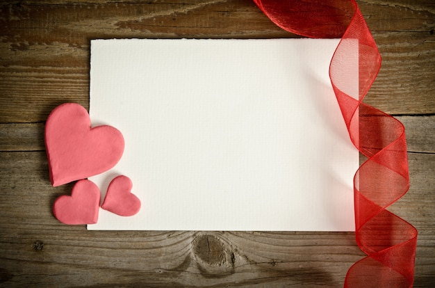 Paper with hearts and ribbons