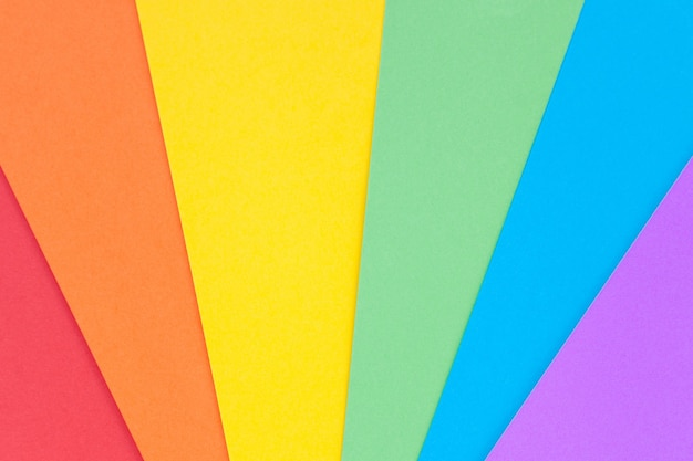 Paper with lgbt colors as a background. rainbow colors. pride community.