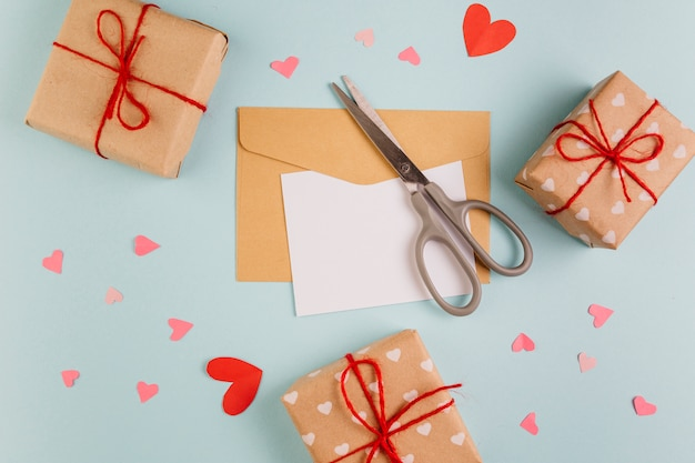 Paper with small gift boxes and scissors