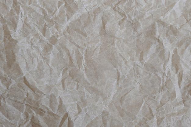 Бумага с морщинами текстуры фона