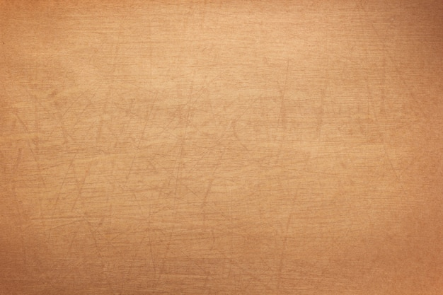 Paper or wooden scratched surface as background texture