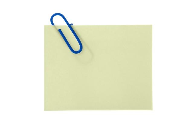 Бумажный желтый стикер с зажимом на белом