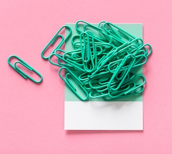 Paperclips on a piece of paper