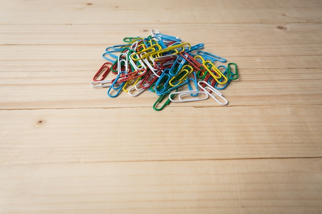 Paperclips on wooden background