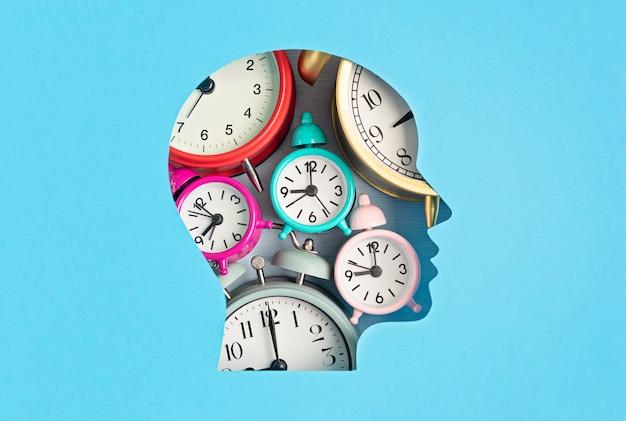 Papercut head filled with alarm clocks