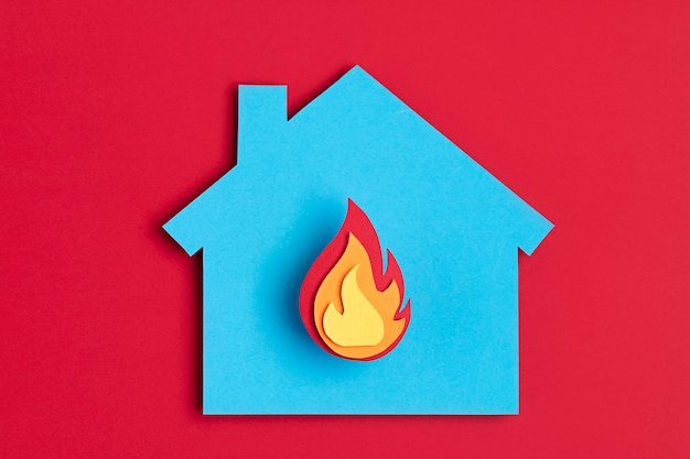 Papercut house with fire inside burnout, psychology, stress, mental illness concept