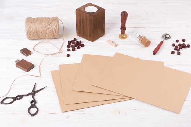 Papers near scissors, twists, candle and usb flash drive