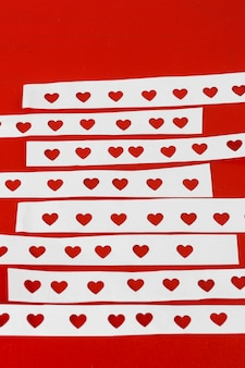 Papers with cut hearts on table