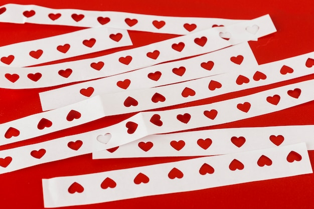 Papers with cut hearts