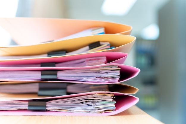 Paperwork stacked files on table