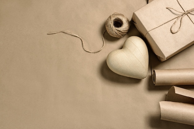 Papier-mache heart, and craft packaging with copy space. gift decoration.