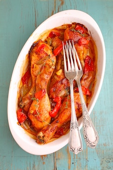 Paprika chicken baked with onion, garlic and red pepper