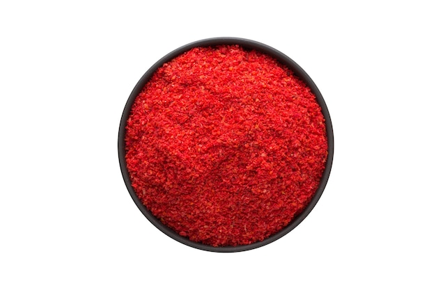 Paprika powder in clay bowl isolated on white background