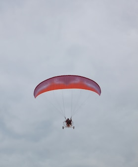 Parachute with a motor in a gloomy sky.