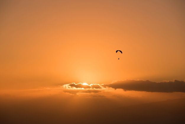 Paraglide shilouette at sunset