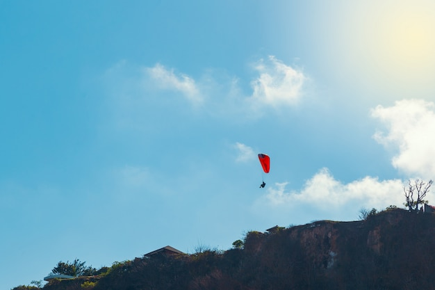 Paraglider and clear blue sky background