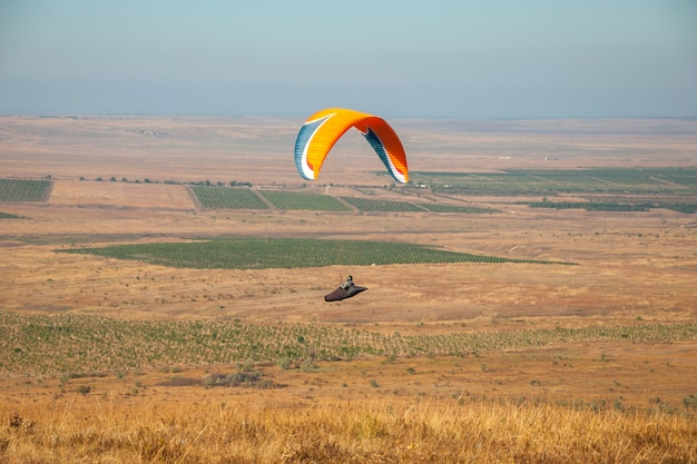 Paraglider flying in the sky on a sunny day active in koktebel