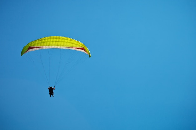 Paragliding along beautiful coastline.