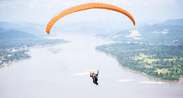 Paragliding in beautiful mountains with river at pha tak suea, amphur sungkom, nongkhai, thailand