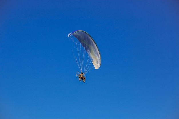 Paragliding on blue sky