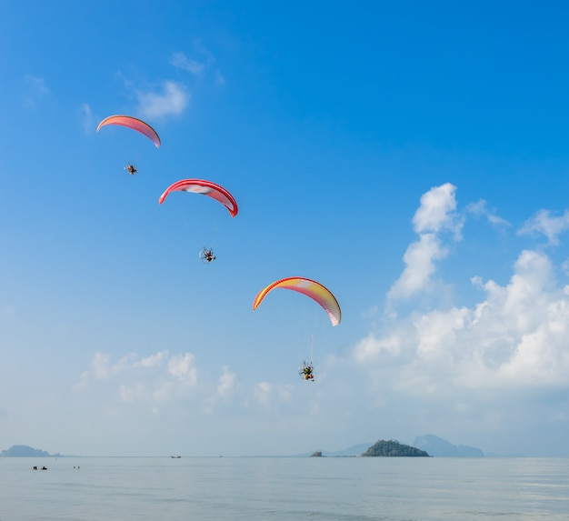 Paragliding over pak meng beach in trang province, thailand
