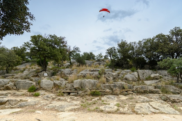 Paragliding over rocks