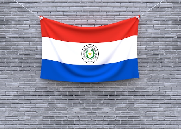 Paraguay flag hanging on brick wall