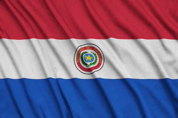 Paraguay flag  is depicted on a sports cloth fabric with many folds.