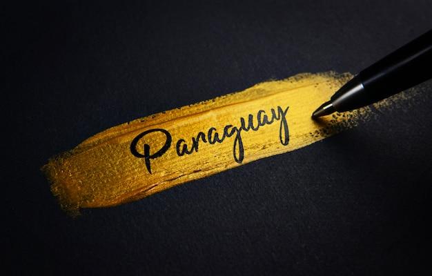 Paraguay handwriting text on golden paint brush stroke