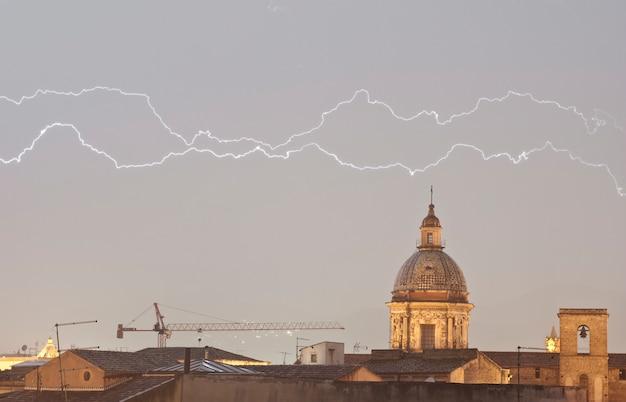 Parallel lightning over urban houses
